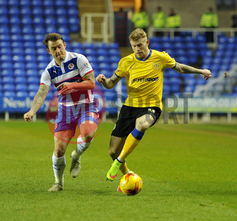 Reading's Simon Cox closes in to challenge Wigan Athletic's James McClean - Photo mandatory by-line: Paul Knight/JMP - Mobile: 07966 386802 - 17/02/2015 - SPORT - Football - Reading - Madejski Stadium - Reading v Wigan Athletic - Sky Bet Championship