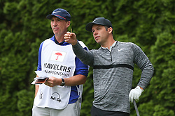 June 23, 2018 - Cromwell, Connecticut, United States - Paul Casey (R) and his caddie wait on the 9th tee during the third round of the Travelers Championship at TPC River Highlands. (Credit Image: © Debby Wong via ZUMA Wire)