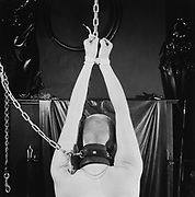 Back of Man Tied Up and Hanging By Chains
