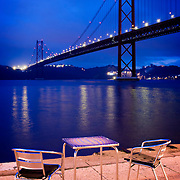 Terrace of a cafe near the 25 de Abril bridge in Lisbon