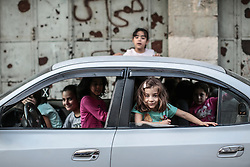 Children in a car in Hebron. From a series of photos commissioned by  British NGO, Medical Aid for Palestinians (MAP).