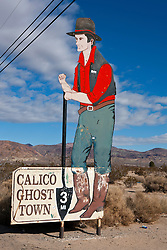 Large road sign with miner advertising Calico Ghost Town, near Calico, California, United States of America