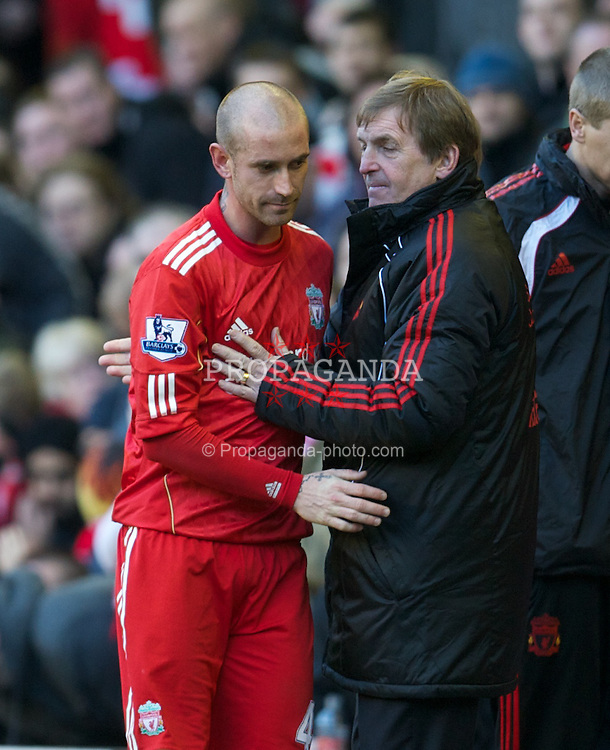LIVERPOOL, ENGLAND - Saturday, February 12, 2011: Liverpool's Raul Meireles and manager Kenny Dalglish MBE during the Premiership match against Wigan Athletic at Anfield. (Photo by David Rawcliffe/Propaganda)