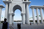 "The entrance to the Turkmenbashi Ruhy Mosque, designed by and named for Saparmurat Niyazov, ""Turkmenbashi,"" who died in 2006. The four minarets are each 91 meters tall, marking the year of Turkmenistan's independence from the Soviet Union. Visitors are forbidden from photographing inside the mosque, which is guarded by armed soldiers."