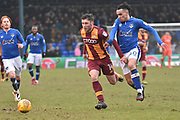 Bradford City forward Shay McCartan (14)  and Oldham Athletic Midfielder, Kean Bryan (40)  during the EFL Sky Bet League 1 match between Oldham Athletic and Bradford City at Boundary Park, Oldham, England on 3 February 2018. Picture by Mark Pollitt.