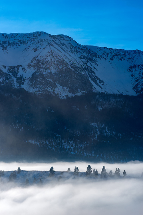 The Wallowa Mountains and Wallowa Lake's west moraine sticking up above a sea of fog in Northeast Oregon.