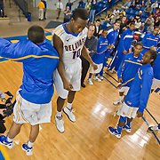 12/03/11 Newark DE: Delaware Sophomore Guard #10 Devon Saddler (middle) celebrates with his teammates after Delaware defeated Colonial Athletic Association rival Drexel, Saturday, Dec. 03, 2011 at the Bob carpenter center in Newark Delaware...Sophomore Guard #10 Devon Saddler would finish the game with 30 total points, Delaware defeat Drexel 71-60.