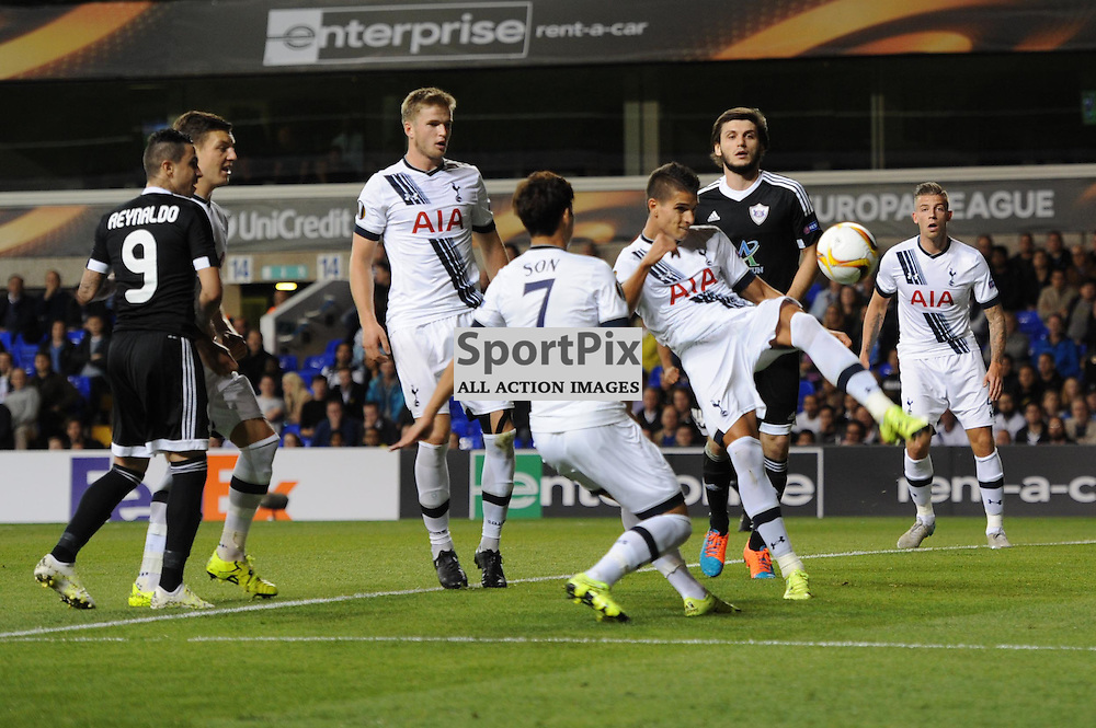 Tottenhams Erik Lamela clears the ball during the Tottenham v Qarabag match in the Europa League group stage
