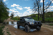 Eastern Oklahoma - Bill and Susan Dragoo drive their Toyota Tacoma truck through a creek along the Trans America Trail. This trail stretches from eastern Tennessee to the Oregon Coast, following dirt roads and trails almost the entire way.