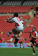 JOHANNESBURG, South Africa, 02 April 2011. Rod Davies of the Reds and Deon van Rensburg of the Lions compete for the ball in the air during the Super15 Rugby match between the Lions and the Reds at Coca-Cola Park in Johannesburg, South Africa on 02 April 2011. .Photographer : Anton de Villiers / SPORTZPICS