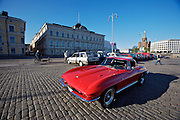 During summer from June to Septemper, every first Friday of the month is Vintage Car Cruising Night. Hundreds of classic American cars cruise around downtown Helsinki and meet at special places to have a good time, here at Kauppatori (Market Square), Uspenski orthodox cathedral in background. Sexiest beast of them all: Corvette Sting Ray Fastback Coupe?.