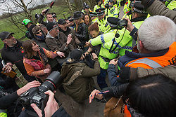 © Licensed to London News Pictures . 17/03/2014 . Barton Moss , Salford , UK . Protesters scuffle with police as they try to block lorries accessing the iGas site . Happy Mondays dancer , Bez  ( Mark Berry ) , joins protesters at the Barton Moss anti-fracking protest site in Salford today (Monday 17th March 2014) . Bez has said he will stand for MP in the constituency of Salford and Eccles in 2015 . Photo credit : Joel Goodman/LNP