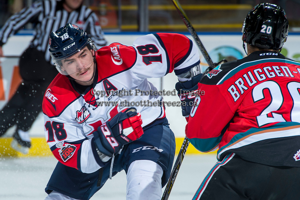 KELOWNA, CANADA - NOVEMBER 17: Tanner Nagel #18 of the Lethbridge Hurricanes is checked by Conner Bruggen-Cate #20 of the Kelowna Rockets on November 17, 2017 at Prospera Place in Kelowna, British Columbia, Canada.  (Photo by Marissa Baecker/Shoot the Breeze)  *** Local Caption ***