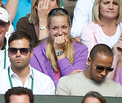 29.06.2011, Wimbledon, London, GBR, ATP World Tour, Wimbledon Tennis Championships, im Bild Tennis player Sabine Lisicki  has a fit of giggles during the Gentlemen's Singles Quarter-Final match on day nine of the Wimbledon Lawn Tennis Championships at the All England Lawn Tennis and Croquet Club. EXPA Pictures © 2011, PhotoCredit: EXPA/ Propaganda/ David Rawcliffe +++++ ATTENTION - OUT OF ENGLAND/UK +++++