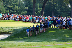 August 25, 2018 - Paramus, NJ, U.S. - PARAMUS, NJ - AUGUST 25:    Tiger Woods of the United States surrounded by fans as he putts during the third round of The Northern Trust on August 25, 2018 at the Ridgewood Championship Course in Ridgewood, New Jersey.   (Photo by Rich Graessle/Icon Sportswire) (Credit Image: © Rich Graessle/Icon SMI via ZUMA Press)