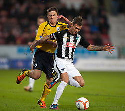 Falkirk's Thomas Grant and Dunfermline's Jordan McMillan..Dunfermline 0 v 1 Falkirk, 26/12/2012..©Michael Schofield.