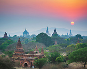 Sun going down behind the temples of Bagan. A few still under repair from the 2016 earthquake