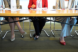 © licensed to London News Pictures. LONDON. UK  14/09/11. Theresa May (right) sits on a panel of leading business women. Home Secretary and Minister for Women and Equalities, Theresa May, launches 'Voluntary Gender Equality Analysis and Reporting' guidance for employers at Eversheds law firm in Central London today (14 Sept 2011). Photo credit should read Stephen SImpson/LNP