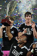 GOLD COAST, AUSTRALIA - OCTOBER 13:  David Raikuna of New Zealand hold the winners trophy aloft after New Zealnad defeated Australia in the Cup final at the Gold Coast Sevens at Skilled Stadium on October 13, 2013 on the Gold Coast, Australia.  (Photo by Matt Roberts/Getty Images)