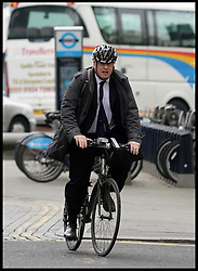 The London Mayor Boris Johnson arrives on his bike to give a speech at the Global University Summit, The Royal Horseguards, London, Wednesday, 29th May 2013.Picture by Andrew Parsons / i-Images