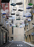 AUSTRALIA - SYDNEY  An art installation featuring bird cages and an audio track of birdsong representing endangered species is hung above a street in Sydney  03/01/2010. STEPHEN SIMPSON...