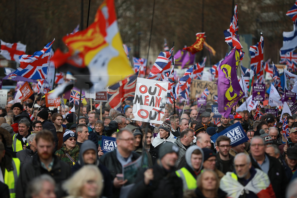 © Licensed to London News Pictures . 09/12/2018. London, UK. A demonstration in support of Brexit , headed by a coalition led by UKIP leader Gerard Batten and former EDL leader Stephen Yaxley-Lennon ( aka Tommy Robinson ) , in Westminster , opposed by a counter-demonstration of Momentum supporters , anti-fascists and Remain campaigners . Photo credit: Joel Goodman/LNP