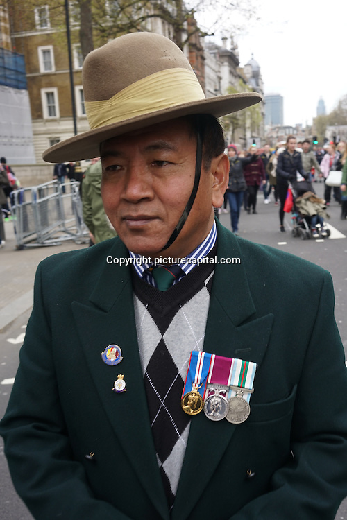 London,England,UK : Hundreds of Gurkha veterans and their supporters rallied on Downing Street in London on April 24, 2016 in a continuation of the Gurkha Justice Campaign. Gurkha veterans — Nepalese natives who fought for Britain — has long protested for their right to abode, meaning they would be able to live and work in Britain without restriction. Current legislation only grants this right to Gurkhas who retired after 1997.. Photo by See Li