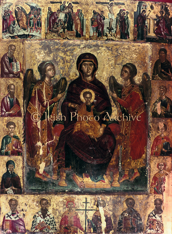 Virgin and Child flanked by two angels At top are scenes of  Christ's crucifixion and resurrection. At the sides and the bottom are images of saints.  16th century Icon from the Cretan School.   Religion Christian Mother Halo