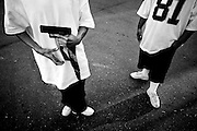 Canoga Park Alabama gang members flash a gun in their Southern California neighborhood, where a court-designated gang injunction allows police to profile and arrest members as though they were terrorists.