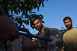 """Syria.<br /> Jamal Maarouf (C) a commander of the FSA enters his secret office with his guards in Idlib province.<br /> <br /> Jamal Maarouf an important commander of the FSA (his group is martyrs of Syria) in the north of Syria gives an interview to the Italian TV channel 7:  """"Europe don't fear us, the syrian revolution did started from the extremist""""  """"I don't believe in eye for eye for eye and tooth for tooth"""" and """"We only need weapons and and if weapons arrived we are able to win the war"""", <br /> Sunday, 16th June 2013<br /> Picture by Daniel Leal-Olivas / i-Images"""