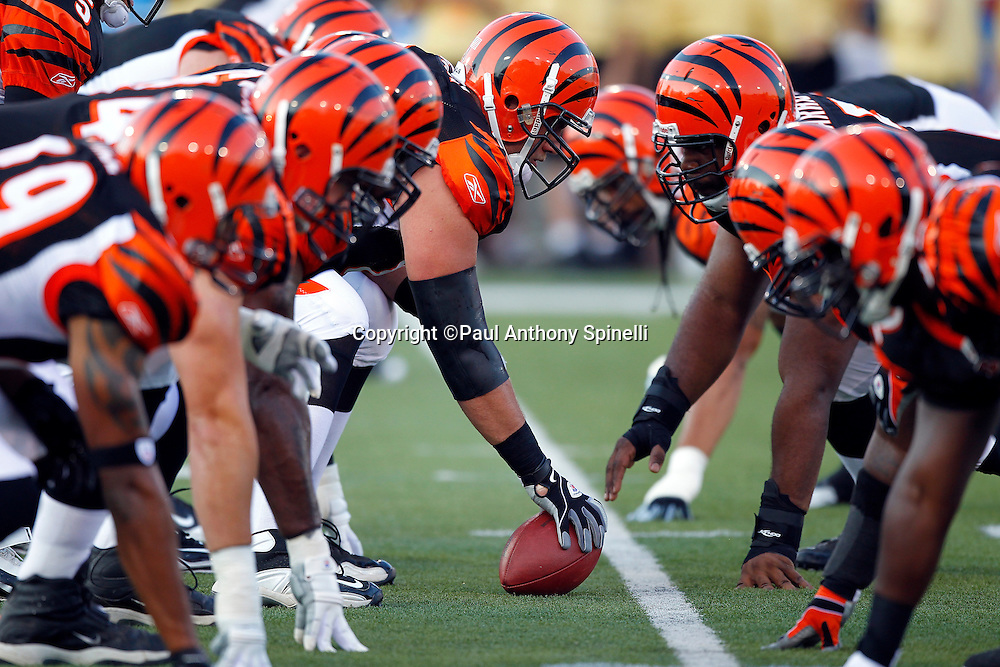 A group of offensive and defensive Cincinnati Bengals linemen get set for a practice snap at the line of scrimmage during pregame warmups at the NFL Pro Football Hall of Fame preseason football game between the Dallas Cowboys and the Cincinnati Bengals on Sunday, August 8, 2010 in Canton, Ohio. The Cowboys won the game 16-7. (©Paul Anthony Spinelli)