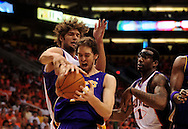 May 23, 2010; Phoenix, AZ, USA; Los Angeles Lakers forward Pau Gasol (16) and Phoenix Suns' Robin Lopez (15) battle for a rebound during the first quarter in game three of the western conference finals in the 2010 NBA Playoffs at US Airways Center.  Mandatory Credit: Jennifer Stewart-US PRESSWIRE