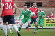 Leo Smith (Wrexham AFC) watches as the ball drops before shooting and scoring a goal to put the visitors 3-1 up with seconds left on the clock. His goal means the visitors take all three points from the Vanarama National League match between York City and Wrexham FC at Bootham Crescent, York, England on 17 April 2017. Photo by Mark P Doherty.