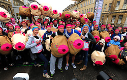 © Licensed to London News Pictures. 19/02/2013.Bristol, City of Bristol. Dermot O'Leary and Greg James with girls from.'Hooters' and the CoppaFeel! Breast cancer charity at the start of the Bath Half Marathon.. Photo credit : Jon Kent/LNP