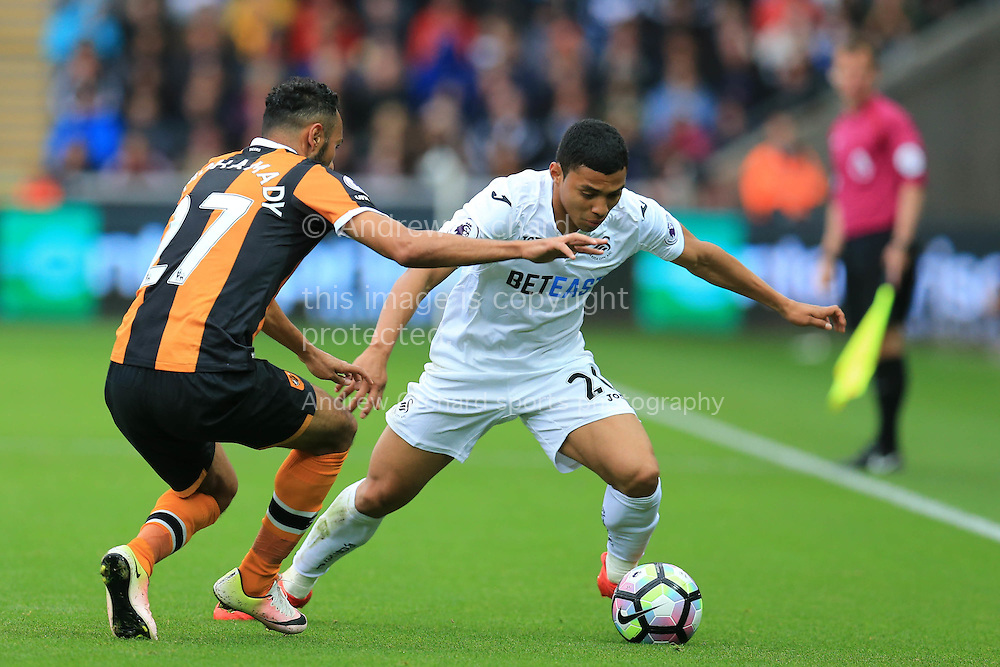 Jefferson Montero of Swansea city goes past Ahmed Elmohamady of Hull city. Premier league match, Swansea city v Hull city at the Liberty Stadium in Swansea, South Wales on Saturday 20th August 2016.<br /> pic by Andrew Orchard, Andrew Orchard sports photography.