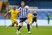 Sheffield Wednesday defender Tom Lees (15) looks to the ball as Swansea City forward Andre Ayew (22) tries to put him under pressure during the EFL Sky Bet Championship match between Sheffield Wednesday and Swansea City at Hillsborough, Sheffield, England on 9 November 2019.