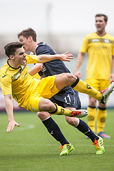 Queen of the South's Ian McShane tackled by Falkirk's Conor McGrandles.<br /> Half time : Falkirk 0 v 0 Queen of the South, Scottish Championship game today at the Falkirk Stadium.<br /> &copy; Michael Schofield.