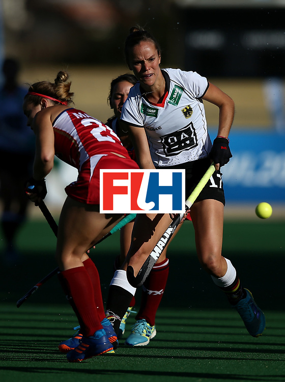 JOHANNESBURG, SOUTH AFRICA - JULY 23: Jana Teschke of Germany controls the ball from Alyssa Manley of United States of America during day 9 of the FIH Hockey World League Women's Semi Finals final match between X at Wits University on July 23, 2017 in Johannesburg, South Africa.  (Photo by Jan Kruger/Getty Images for FIH)