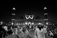 Indian Muslims gather after evening prayers as they break fast on one of the last days of Ramadan at the Jama Masjid on September 19, 2009 in New Delhi, India. Muslims all over the world are preparing for the end of the fasting month of Ramadan which is marked by the celebration of Eid al-Fitr, dependent on the sighting of the new moon.Photo by Keith Bedford