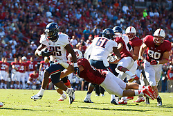 PALO ALTO, CA - OCTOBER 06: Running back Ka'Deem Carey #25 of the Arizona Wildcats is tackled by linebacker A.J. Tarpley #17 of the Stanford Cardinal during the fourth quarter at Stanford Stadium on October 6, 2012 in Palo Alto, California. The Stanford Cardinal defeated the Arizona Wildcats 54-48 in overtime. (Photo by Jason O. Watson/Getty Images) *** Local Caption *** Ka'Deem Carey; A.J. Tarpley