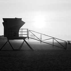 Pensacola Beach Florida lifeguard tower two sunrise black and white photo on Casino Beach. Pensacola Beach is a coastal city on Santa Rosa Island in the Emerald Coast of the Southeastern United States of America. Photo is high resolution. Copyright ⓒ 2018 Paul Velgos with All Rights Reserved.