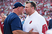 FAYETTEVILLE, AR - SEPTEMBER 5:  Head Coach Sean Kugler of the UTEP Miners and Head Coach Bret Bielema of the Arkansas Razorbacks shake hands after the game at Razorback Stadium on September 5, 2015 in Fayetteville, Arkansas.  The Razorbacks defeated the Miners 48-13.  (Photo by Wesley Hitt/Getty Images) *** Local Caption *** Sean Kugler; Bret Bielema