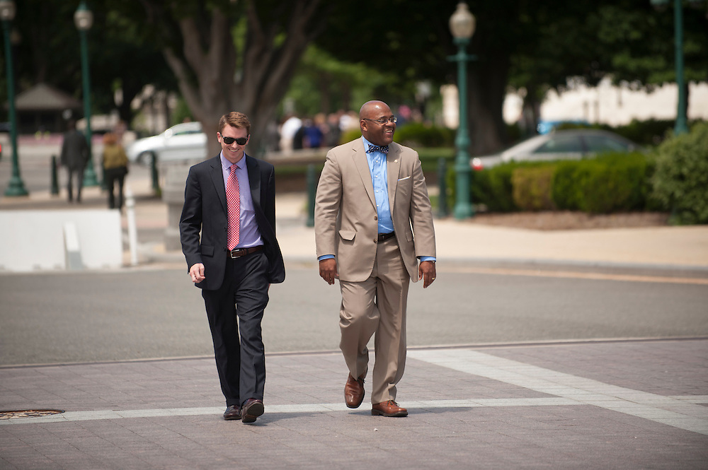 "Senator William Maurice ""Mo"" Cowan (D-MA) walks to an appointment on Capitol Hill with a staff member. (NOTE: Cowan's office refused to identify the staffer)"