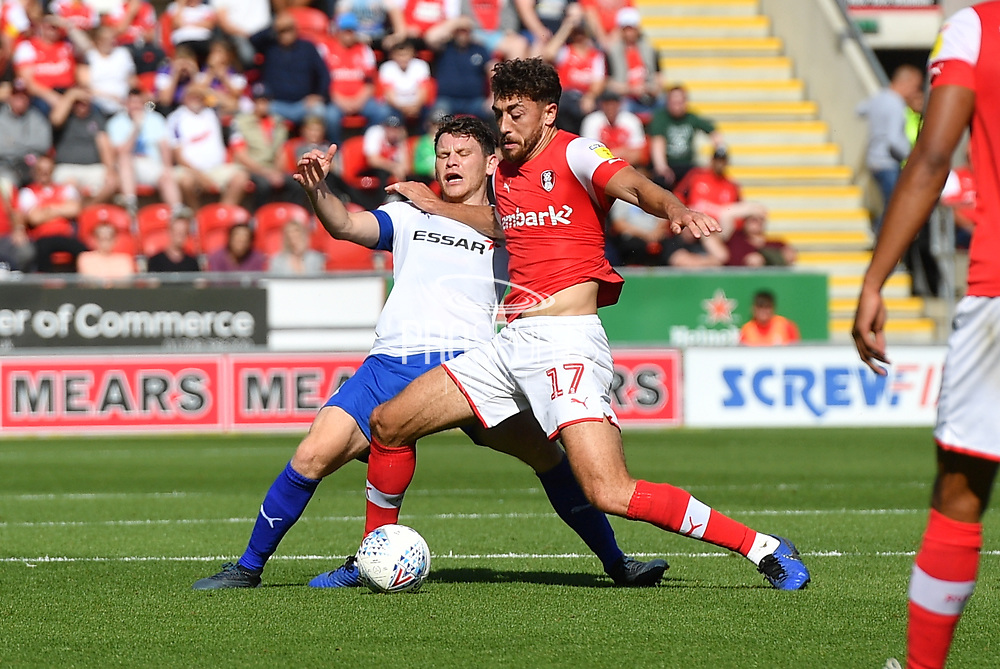 Rotherham United player Matt Crooks  and Tranmere Rovers player Connor Jennings (11)during the EFL Sky Bet League 1 match between Rotherham United and Tranmere Rovers at the AESSEAL New York Stadium, Rotherham, England on 31 August 2019.