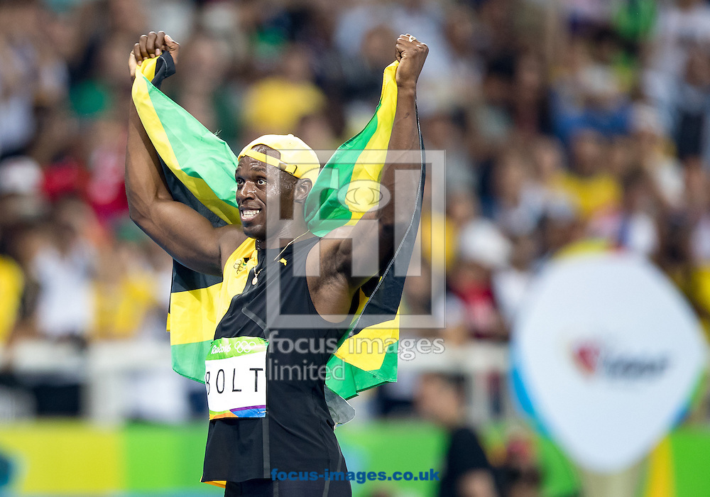 Usain Bolt of Jamaica retains his title and wins his third successive Gold Medal in the Men's 100m on day nine of the XXXI 2016 Olympic Summer Games in Rio de Janeiro, Brazil.<br /> Picture by EXPA Pictures/Focus Images Ltd 07814482222<br /> 14/08/2016<br /> *** UK &amp; IRELAND ONLY ***<br /> <br /> EXPA-GRO-160815-5414.jpg