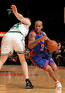 Stephon Marbury of the  New York Knicks drives around Brian Scalabrine of the Boston Celtics at Madison Square Garden in New York City. Sunday 04 December 2005 The Knicks won the game 102-99 Photo by Andrew Gombert for the New York Times