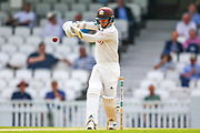 Sam Curran of Surrey hits the ball to the boundary for four runs during the Specsavers County Champ Div 1 match between Surrey County Cricket Club and Kent County Cricket Club at the Kia Oval, Kennington, United Kingdom on 10 July 2019.