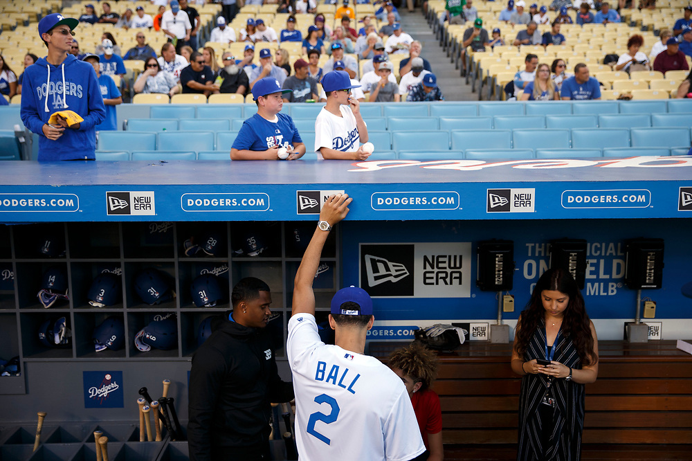 Lakers draft pick Lonzo Ball hangs out in the dugout before throwing out the first pitch at Dodger Stadium on Friday, June 23, 2017 in El Segundo, California. The Lakers selected Lonzo Ball as the No. 2 overall NBA draft pick and is the son of LaVar Ball. © 2017 Patrick T. Fallon