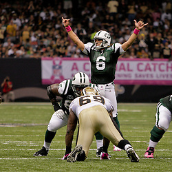 2009 October 04: New York Jets quarterback Mark Sanchez (6) signals at the line during a 24-10 win by the New Orleans Saints over the New York Jets at the Louisiana Superdome in New Orleans, Louisiana.