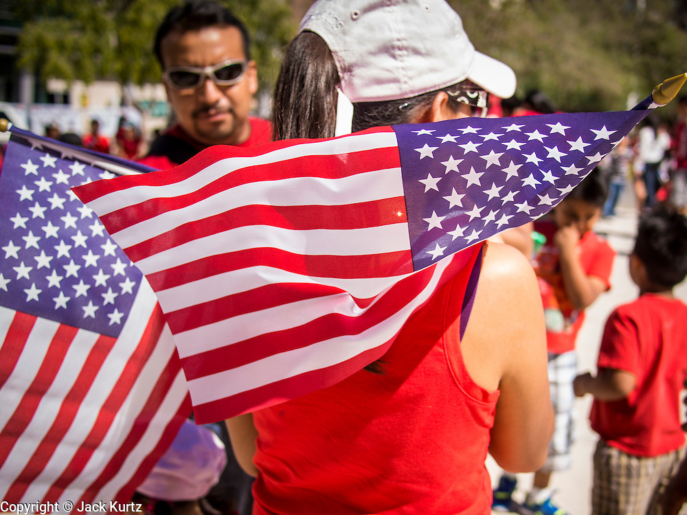 05 OCTOBER 2013 - PHOENIX, ARIZONA:     More than 1,000 people marched through downtown Phoenix Saturday to demonstrate for the DREAM Act and immigration reform. It was a part of the National Day of Dignity and Respect organized by the Action Network.    PHOTO BY JACK KURTZ
